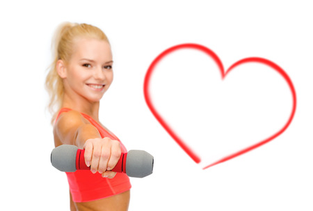 sporty: fitness, sport and diet concept - smiling beautiful sporty woman, focus on dumbbell