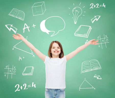 stretched out: advertising, gesture, education, childhood and people - smiling girl in white t-shirt with stretched out arms over green board with doodles background Stock Photo
