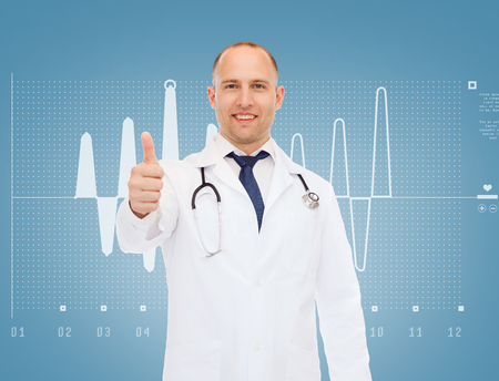 approvement: healthcare, profession, gesture and medicine concept - smiling male doctor with stethoscope showing thumbs up over cardiogram background