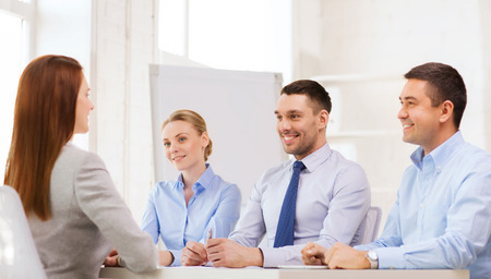 career person: business, career and office concept - smiling businesswoman at job interview in office