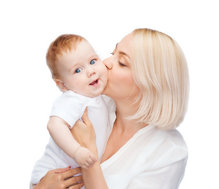 family, child and parenthood concept - happy mother kissing smiling baby photo