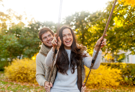 in nice: love, relationship, family and people concept - smiling couple hugging in autumn park Stock Photo