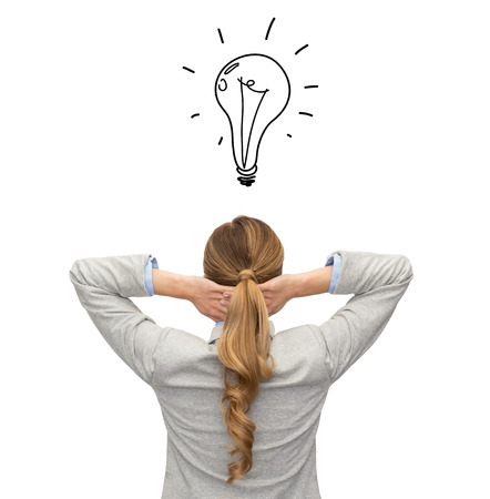 business, education, people and office concept - businesswoman or teacher in suit from back over white background with bulb doodle photo
