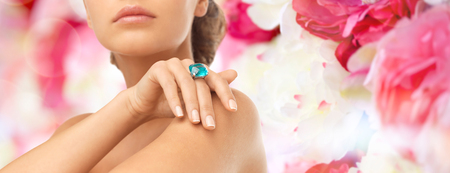 wedding, bridal jewelry and luxury concept - close up of beautiful woman hand with big blue cocktail ring photo