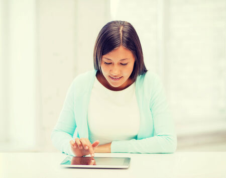 scholar: education, technology and internet concept - smiling student girl with tablet pc Stock Photo