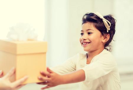 birthday presents: holidays, presents, christmas,  birthday concept - happy child girl with gift box Stock Photo
