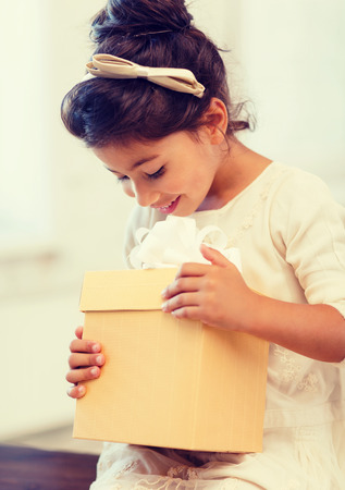 holidays, presents, christmas,  birthday concept - happy child girl with gift box photo
