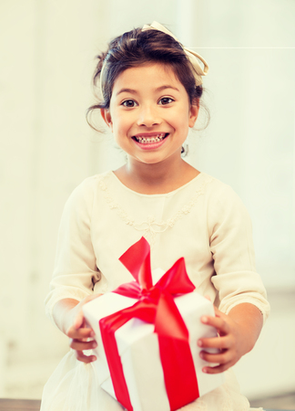 grateful: holidays, presents, christmas, birthday concept - happy child girl with gift box