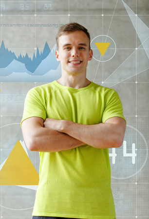 sport, fitness, lifestyle and people concept - smiling man in gym photo