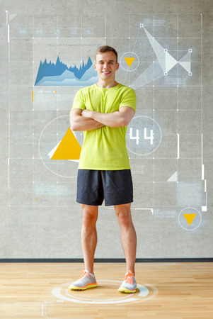 home trainer: sport, fitness, lifestyle and people concept - smiling man in gym