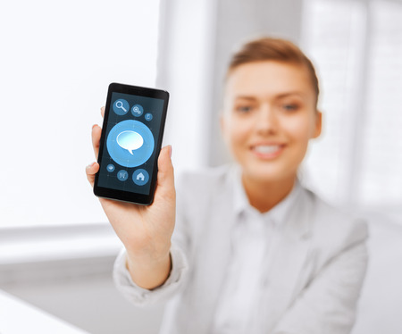 business, office, technology and education concept - close up of businesswoman or student showing bubble icon on smartphone screen photo