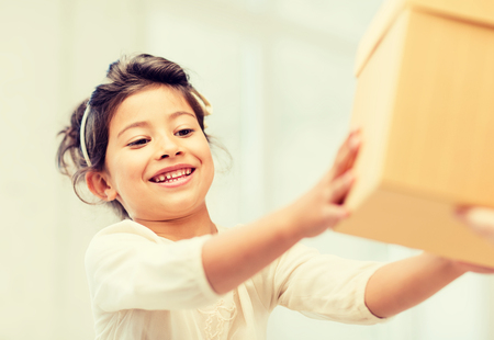 holidays, presents, christmas, birthday concept - happy child girl with gift box