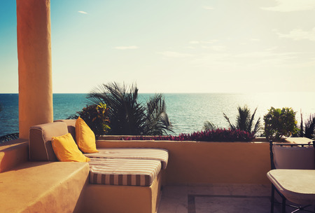 tourist resort: vacation, home and travel concept - sea view from balcony of home or hotel room Stock Photo