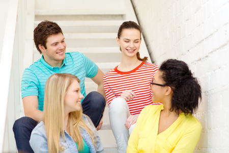 frienship: frienship and education concept - smiling teenagers hanging out