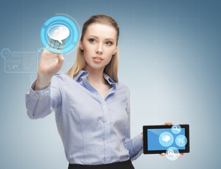business, future technology and people concept - young businesswoman working with tablet pc and interface icon projections photo