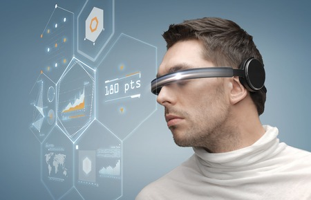VIRTUAL REALITY: future, technology, business and people concept - man in futuristic glasses