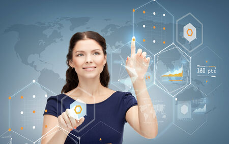business, future, technology and people concept - smiling young businesswoman working with virtual screen photo