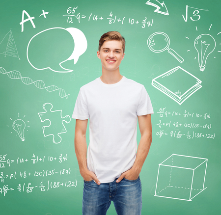 t-shirt design, education, school, advertising and people concept - smiling young man in blank white t-shirt over green board background with doodles photo