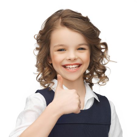 pre teens: happy children and gestures concept - picture of beautiful pre-teen girl showing thumbs up