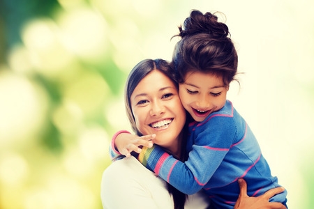 family, children and happy people concept - hugging mother and daughter Stok Fotoğraf