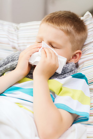 grippe: childhood, healthcare and medicine concept - ill boy with flu at home