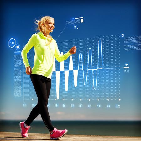 フィットネス、スポーツ、トレーニング、技術、ライフ スタイルのコンセプト - イヤホンでアウトドア スポーツをやっている女性 写真素材