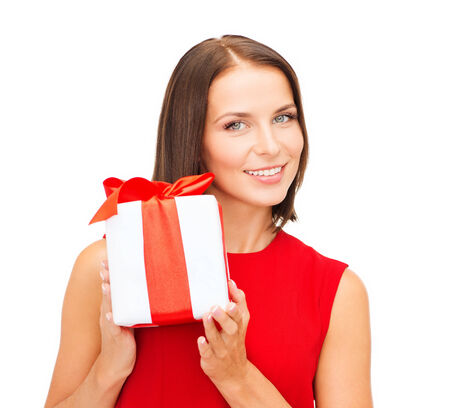 fancy box: christmas, x-mas, valentines day, celebration concept - smiling woman in red dress with gift box Stock Photo