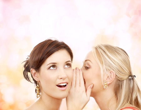 blab: friendship, happiness and people concept - two smiling women whispering gossip