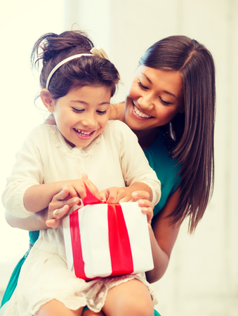 grateful: holidays, presents, christmas, x-mas concept - happy mother and child girl with gift box