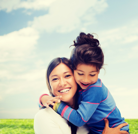 family, children and happy people concept - hugging mother and daughter Reklamní fotografie
