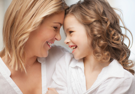 mother and teen daughter: bright picture of hugging mother and daughter Stock Photo