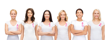 nice breast: healthcare and medicine concept - group of smiling women in blank t-shirts with pink breast cancer awareness ribbons