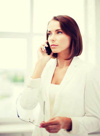 business concept - confused woman with smartphone photo