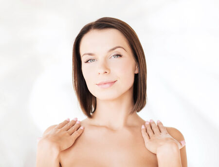 sensitive skin: beauty, spa, health and people concept - beautiful woman touching her shoulders Stock Photo