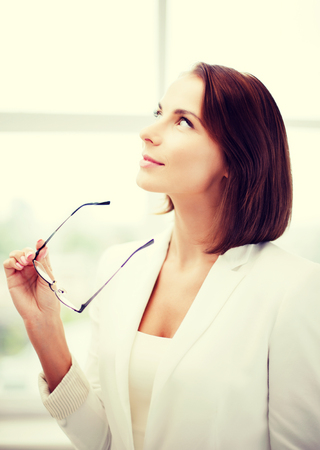 nonsurgical: business and vision correction concept - businesswoman with eyeglasses in office