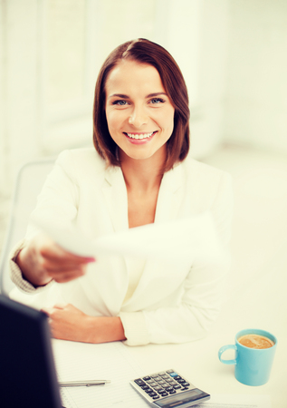 business concept - businesswoman giving papers in office photo