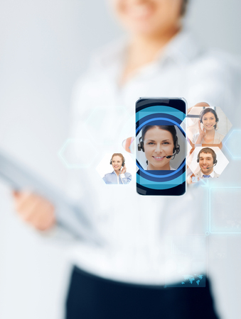 business, education, people and technology concept - close up of businesswoman showing smartphone screen with video chat icons photo