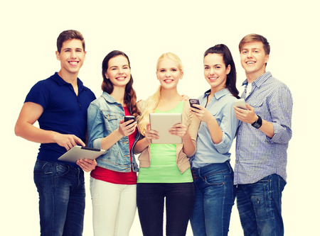 five people: education and modern technology concept - smiling students using smartphones and tablet pc
