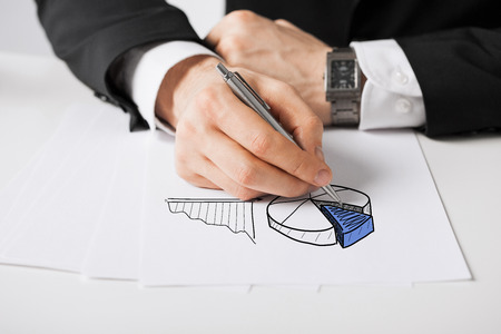business, marketing, planning and people concept - close up of male hand with pen drawing graph on white paper Stok Fotoğraf
