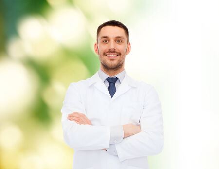 lab coats: healthcare, profession and medicine concept - smiling male doctor in white coat over white background Stock Photo