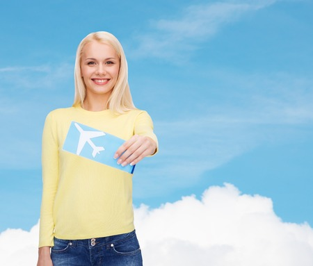 flight ticket: travel and transportation concept - smiling young woman with airplane ticket