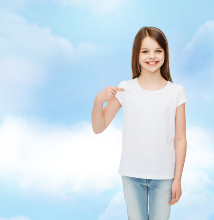 little finger: advertising, dream, childhood, gesture and people - smiling little girl in white t-shirt pointing finger on herself over cloudy sky background