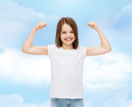 arms raised girl: advertising, dream, childhood, gesture and people - smiling little girl in white blank t-shirt with raised arms over cloudy sky background