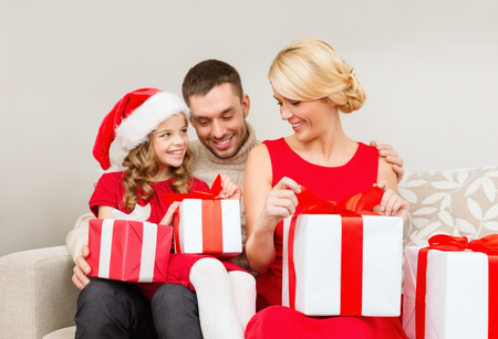 family, christmas, x-mas, winter, happiness and people concept - happy family opening photo