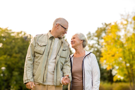 family, age, tourism, travel and people concept - senior couple in park photo
