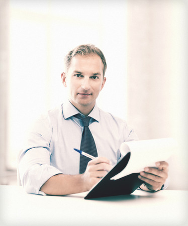 accountancy: picture of handsome businessman taking employment inteview Stock Photo