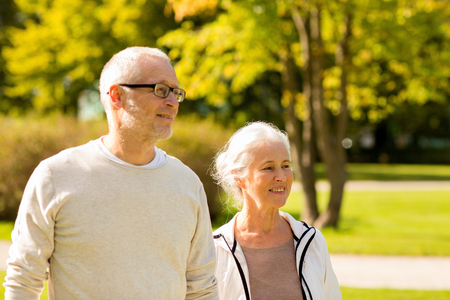city park: family, age, tourism, travel and people concept - senior couple in city park