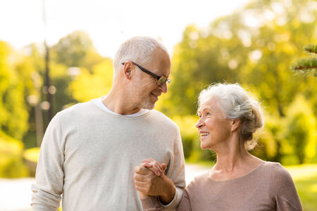 family, age, tourism, travel and people concept - senior couple in city park photo