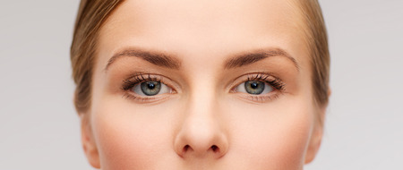 perfect: health, vision and beauty concept - closeup of face of beautiful young woman Stock Photo