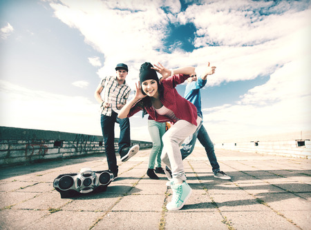 hip hop man: sport, dancing and urban culture concept - group of teenagers dancing